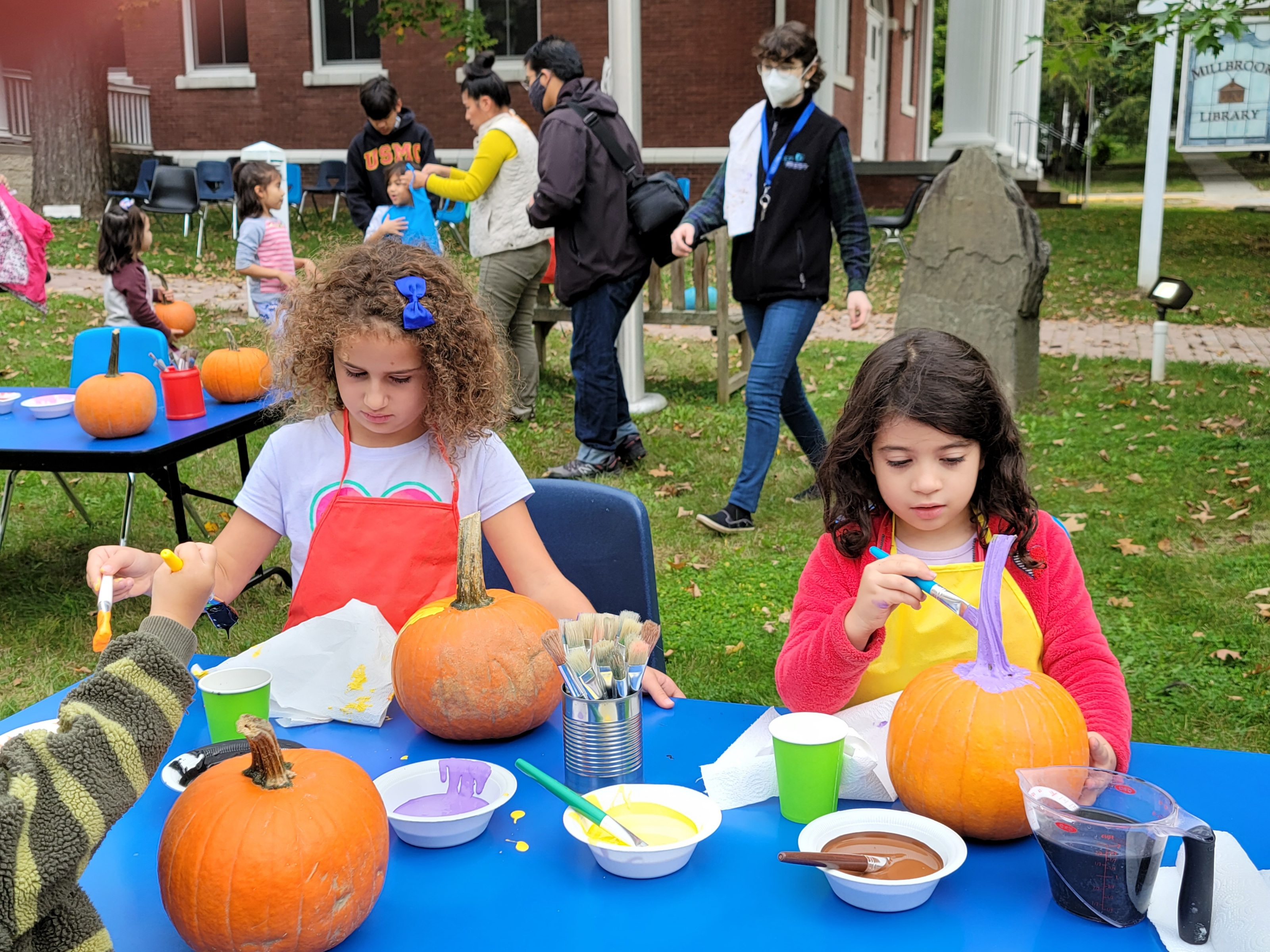 <strong>From left, Isabella Blum, 7, and her friend, Nora Diamant, also 7, were busy painting faces on pumpkins at the Fall in Love with Millbrook pumpkin painting station at the Millbrook Library on Saturday, Oct. 9.<em>Photo by Judith O'Hara Balfe</em></strong>