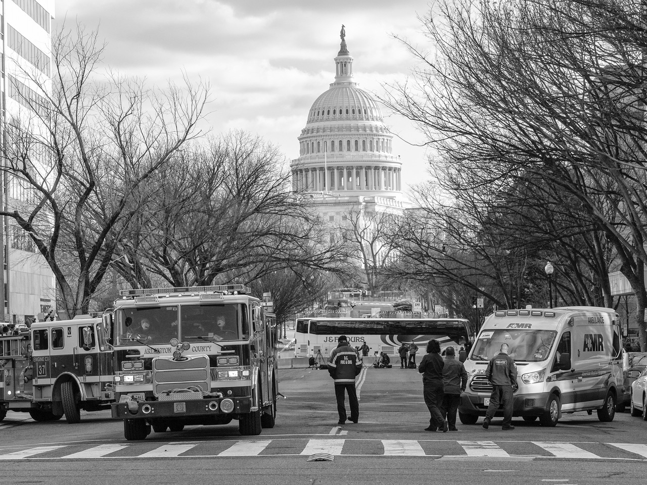 <strong>Vehicles and barriers cut off most visitors from the Capitol building during the Jan. 20 inauguration. <em>Photo By Anne Day</em></strong>