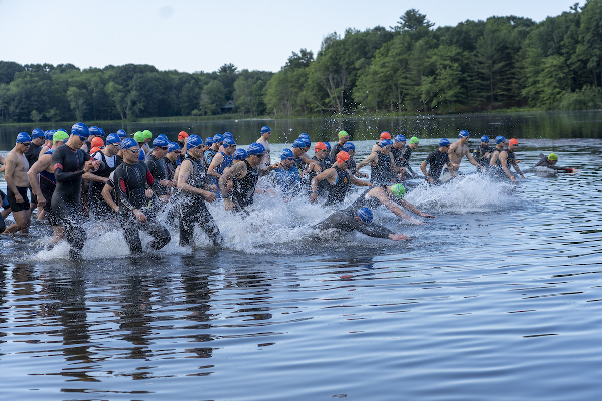 <strong>Competing in the Stissing Triathlon last summer, participants from the local region and beyond set off on a course that featured a one-half mile swim at the Pine Plains Beach, followed by a 16.5 mile bike race and a 3.3 mile run around the lake.<em>Archived photo by Kaitlin Lyle</em></strong>