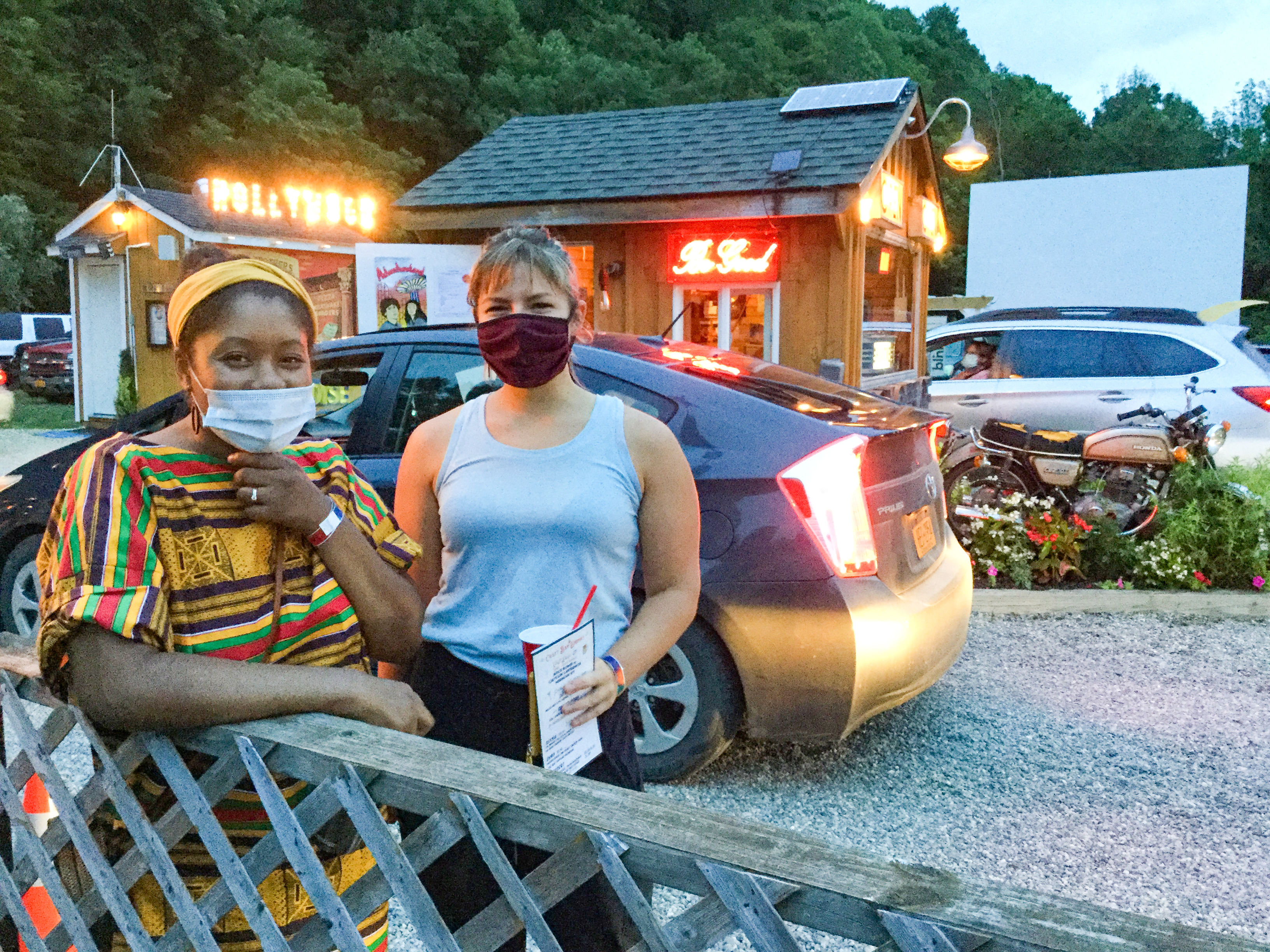 <strong>Abigail Herace, left, and Liz Burroughs attended the Social Justice Block Party at Four Brothers Drive-In Theatre in Amenia on Thursday, July 16.<em> Photo by Kaitlin Lyle</em></strong>