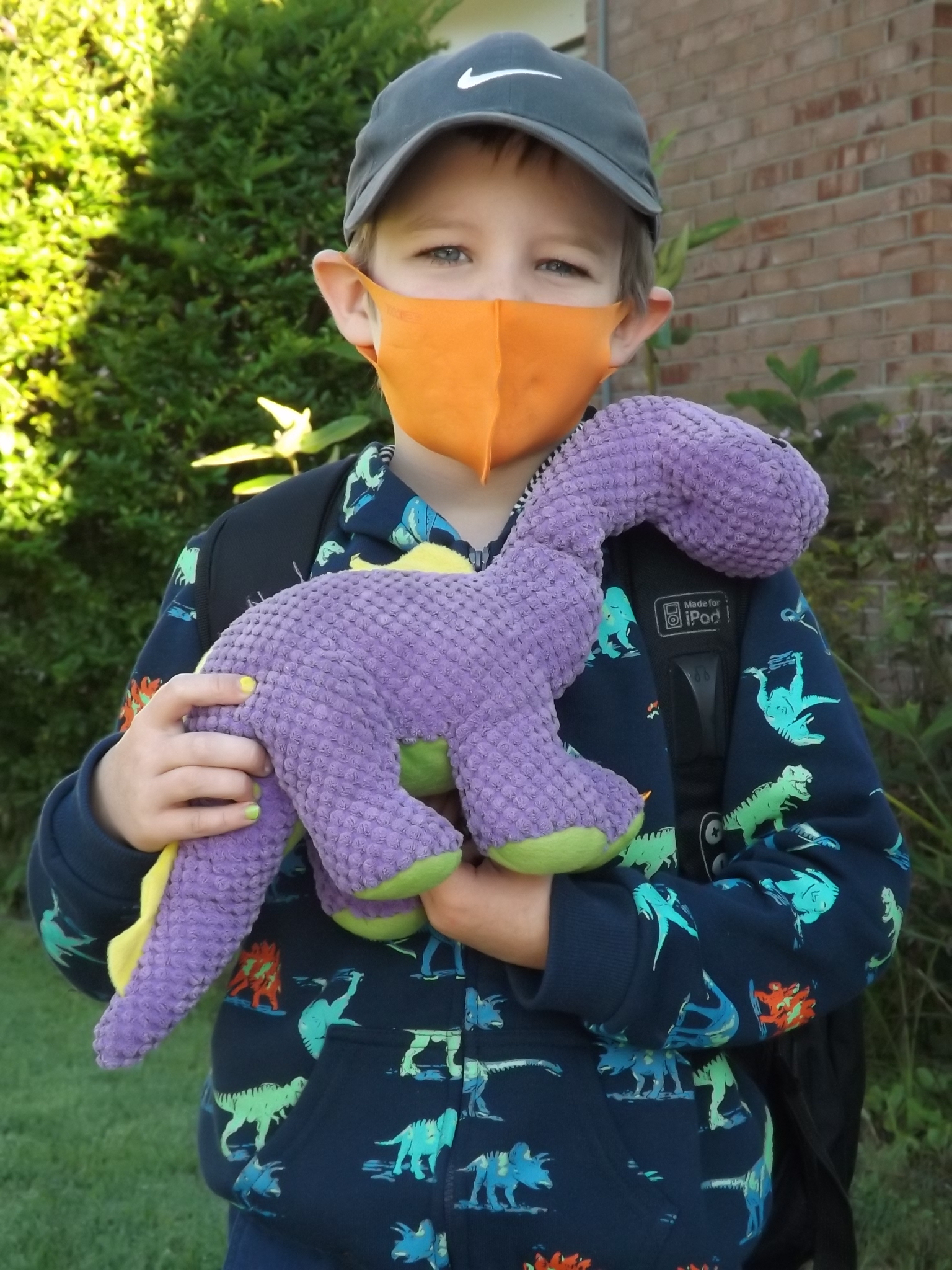 <strong>With help from his trusted dinosaur Dino, Benjamin Haymann Snyder, 6, embarked on his first day of first grade.<em>Photoby Kaitlin Lyle</em></strong>