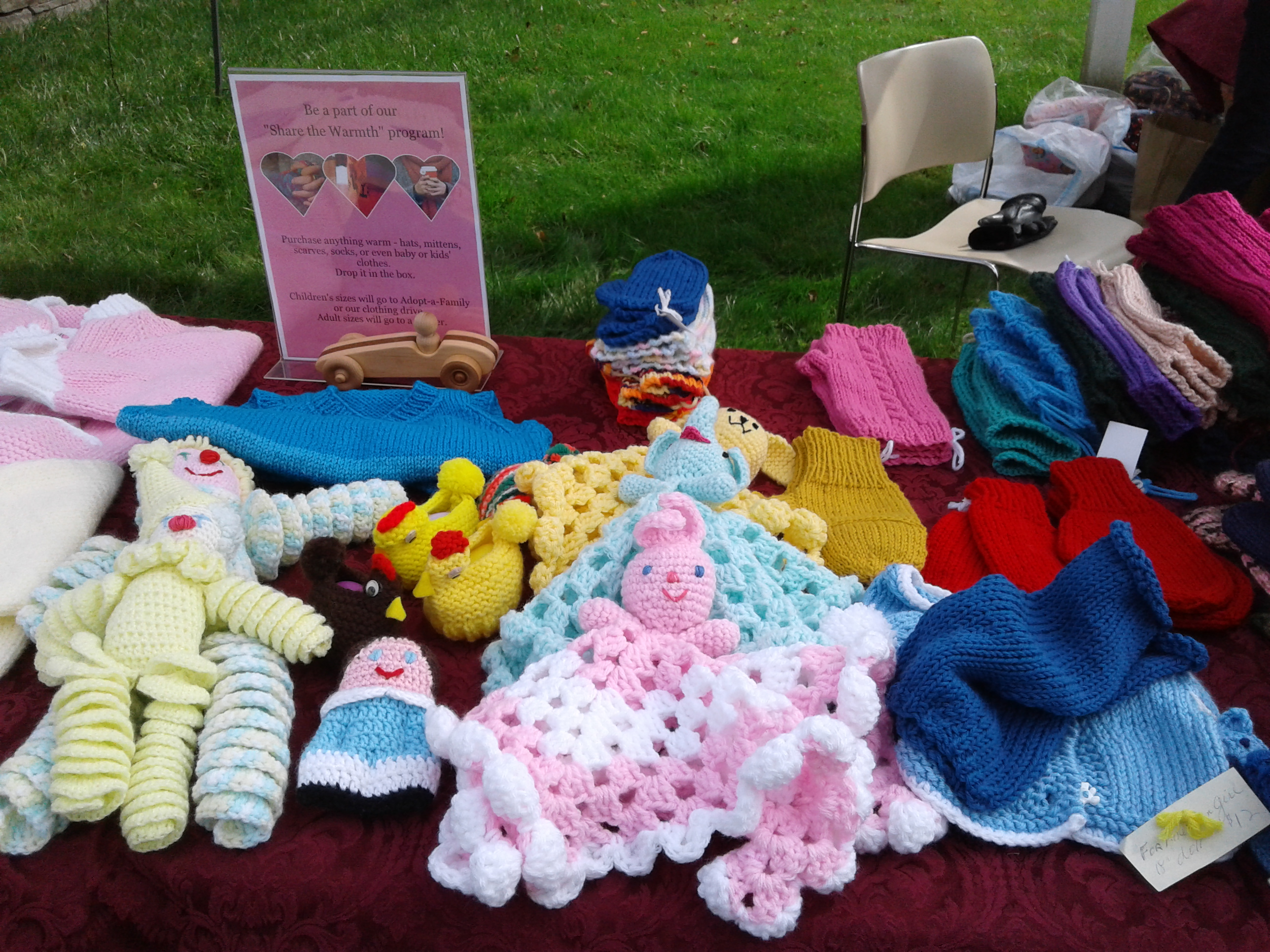 <strong>From toys and sweaters to fingerless gloves and hats, an array of hand-knitted items was laid out on a table, waiting to be bought and loved.<em>Photo by Kaitlin Lyle</em></strong>