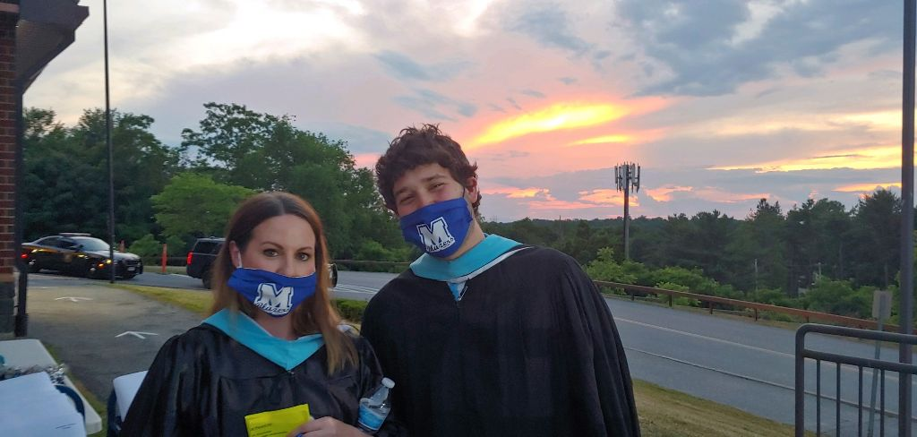 <strong>Graduation counselors Lauren Prince and Tom Chanowsky said they were happy to take part in Millbrook High School's graduation day on Thursday, June 18, as the sun set on an extraordinary day in what was an extraordinary year. </strong><em><strong>Photo by Brian Frie</strong></em>