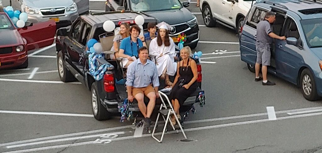 <strong>One family settled in for the parking lot graduation ceremony, a night to remember as unique and special because of the effort made by the Millbrook Central School District to make graduation one-of-a-kind for the Class of 2020. </strong><em><strong>Photo by Brian Frie</strong></em>