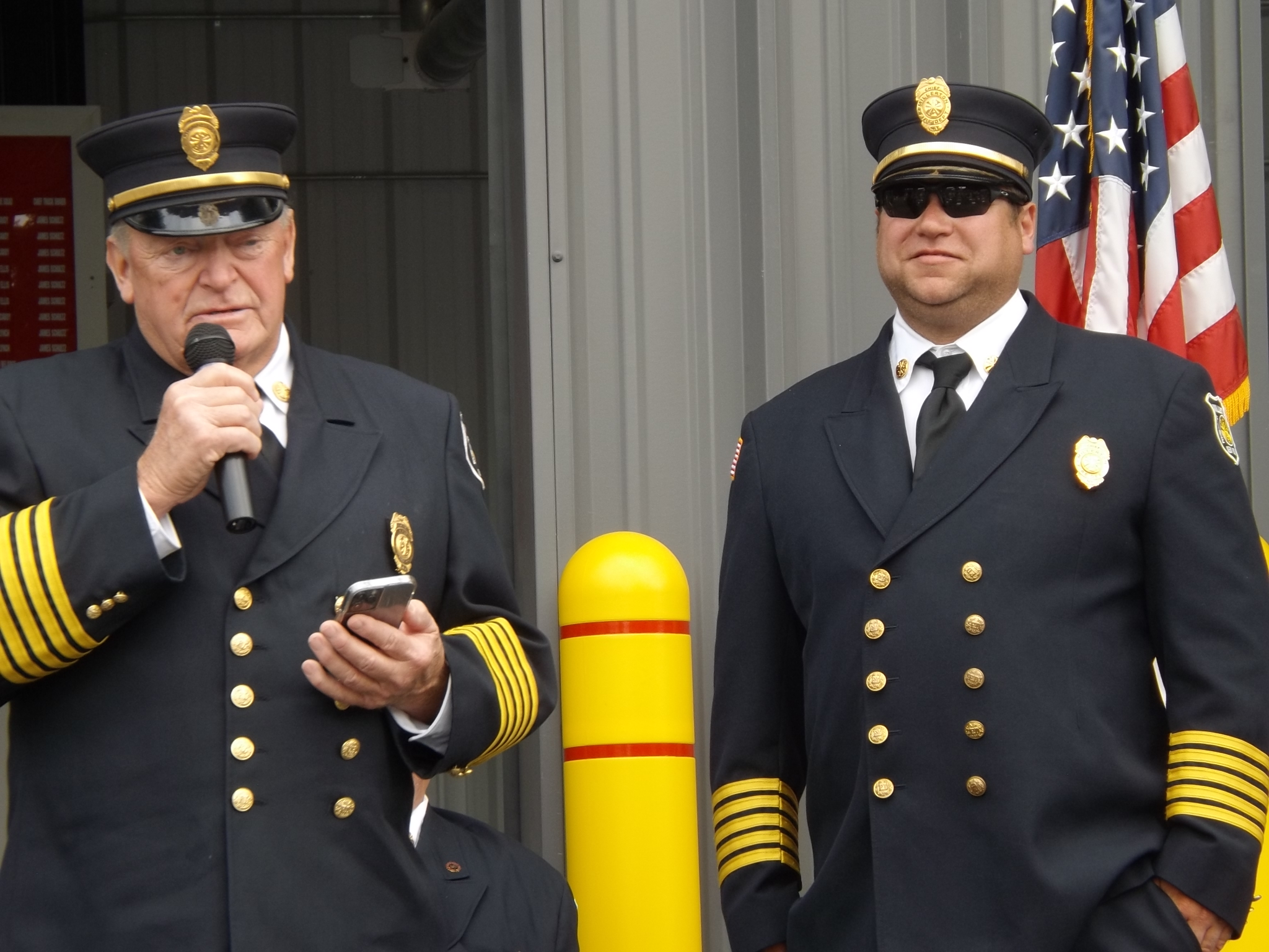 <strong>From left, Millerton Fire Company President Lenny Morrison, with help from Fire Chief Jason Watson, announced the dedication of plaques to be hung on the company's fire equipment in honor of company members past and present. <em>Photo by Kaitlin Lyle.</em></strong>