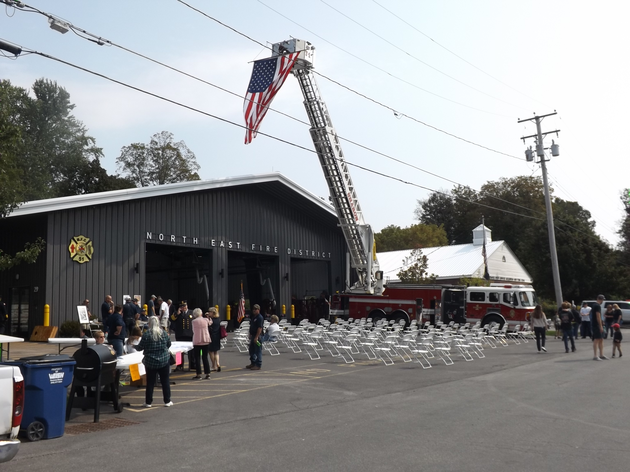 <strong>From the end of a firetruck's ladder, an American flag was hung and could be seen swaying above the Annex where the Open House was held Sunday afternoon, Sept. 12.<em>Photo by Kaitlin Lyle.</em></strong>