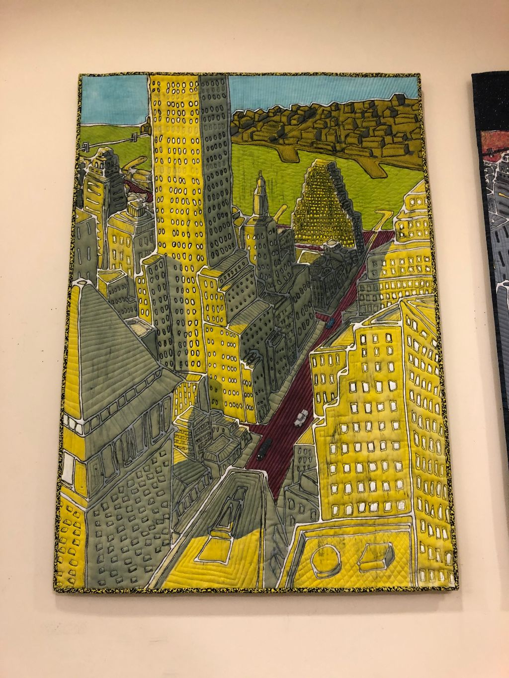 """<strong>Textile artist K. Velis Turan makes """"quilts"""" of metal, colorful and intricate, below, now on display inside the library. <em>P</em></strong><em>hoto by Judith O'Hara Balfe</em>"""