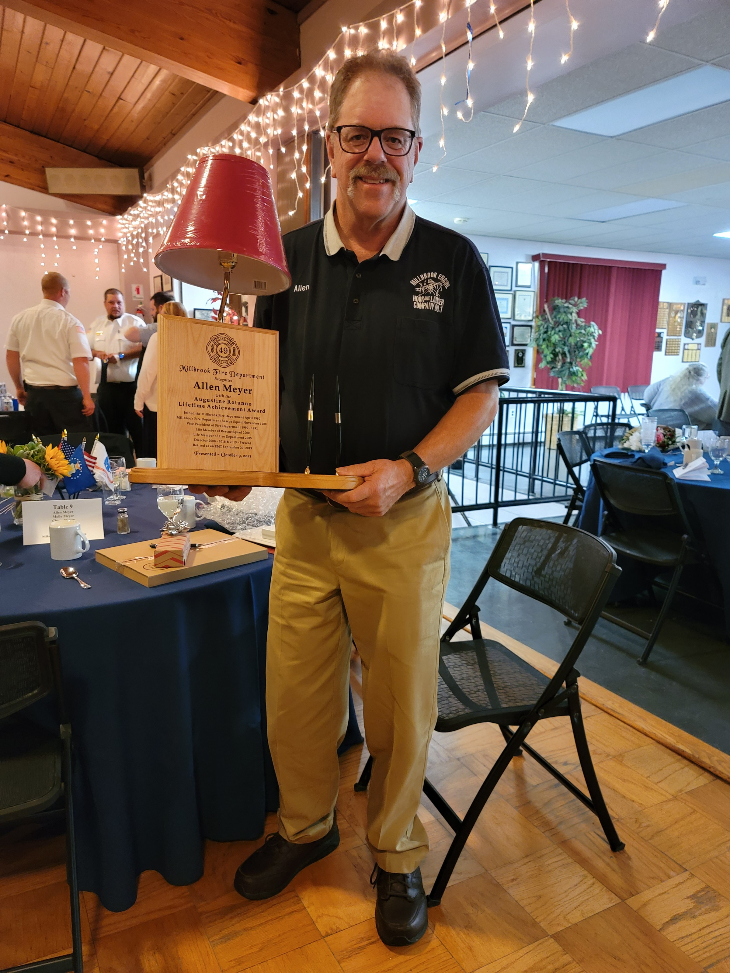 <strong>Allen Meyer, the recipient of the Augustine Rotund Lifetime Achievement Award, held his commemorative lamp and award at the fire company's annual dinner on Saturday, Oct. 9.<em>Photoby Judith O'Hara Balfe</em></strong>