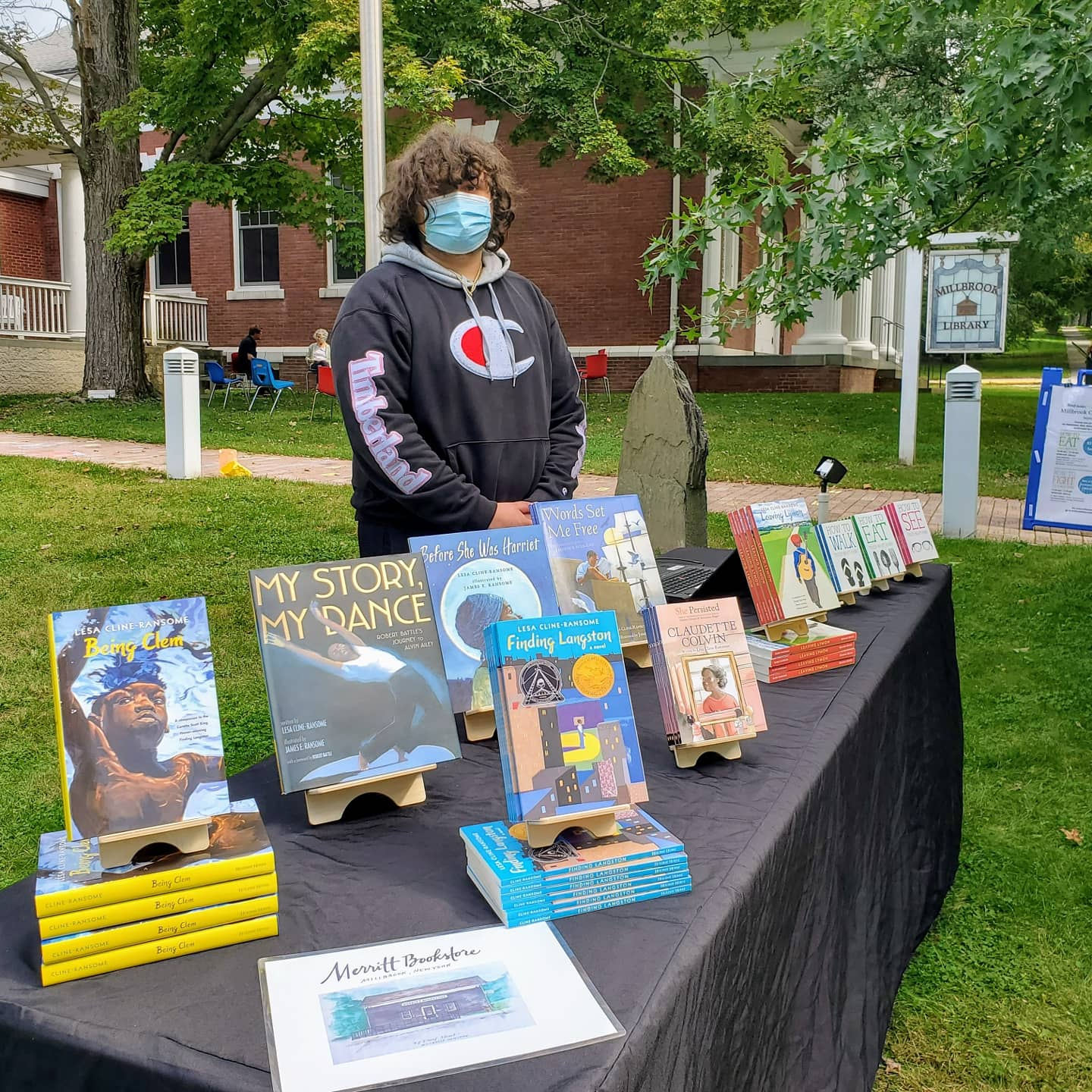 <strong>A salesperson from Merritt Bookstore staffed the book sale table outside the Millbrook Library as part of the 2021 Community Read that was held as an alternative to the traditional Millbrook Literary Festival this past weekend.<em>Photoby Sam Falk</em></strong>