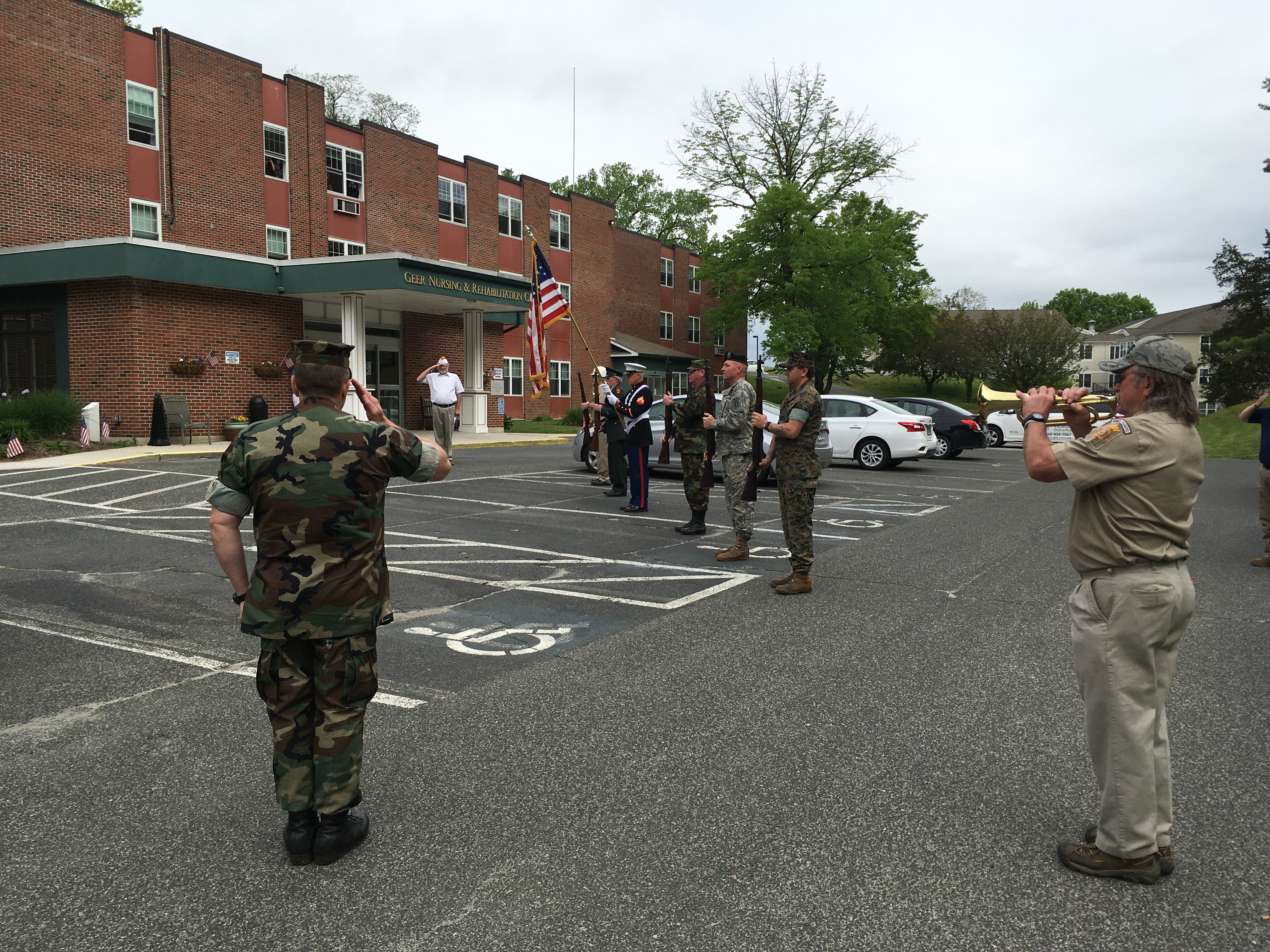 <strong>Taps was played outside Geer Nursing and Rehabilitation in North Canaan. <em>Photo by Cynthia Hochswender</em></strong>