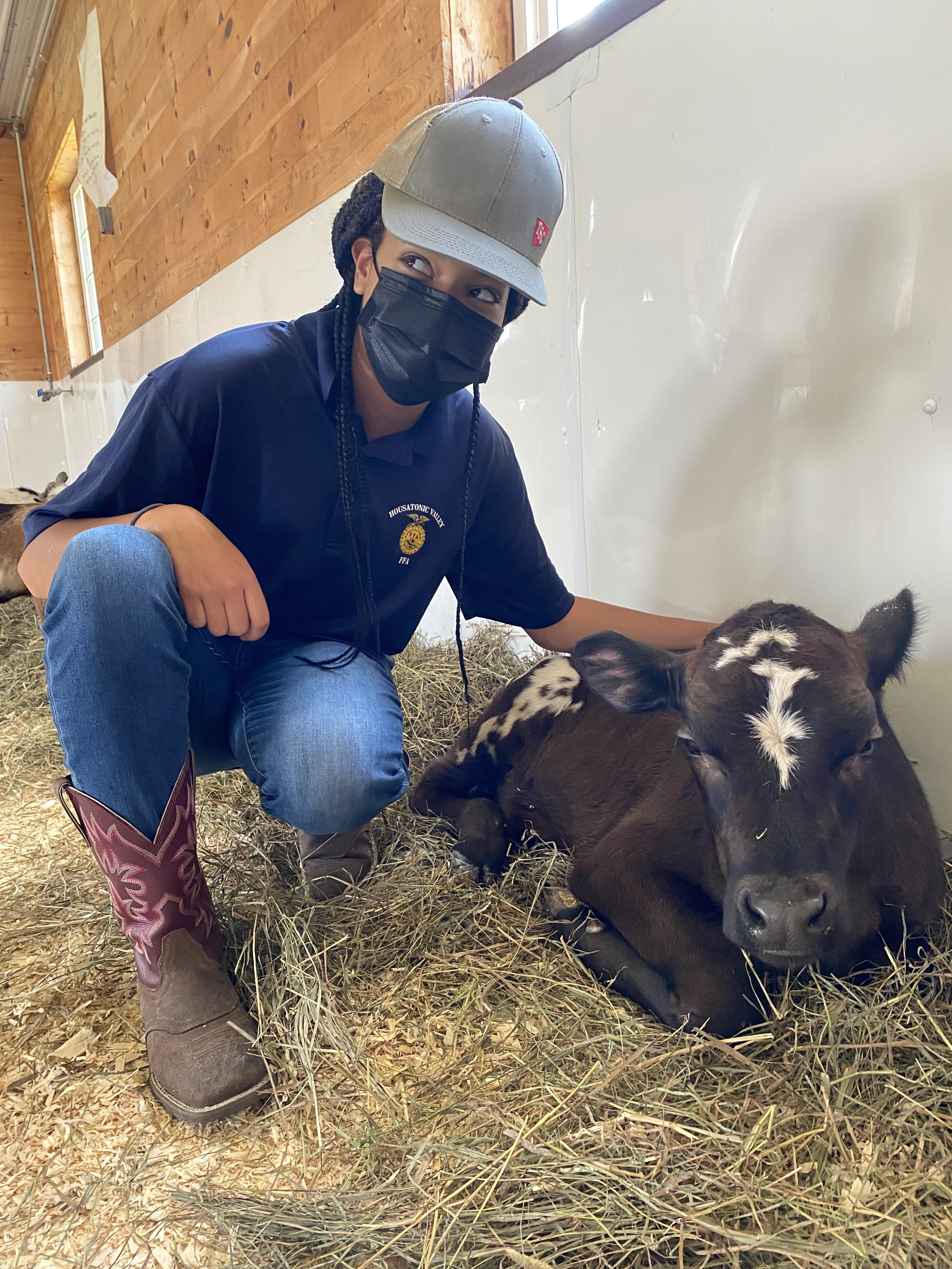 <strong>Kori Ann Wiggins from Housatonic Valley Regional High School was in the FFA barn on Saturday, Sept. 4, during the Goshen Fair, helping introduce youngsters to some of the baby animals in the students' petting zoo. <em>Photo by Cynthia Hochswender</em></strong>