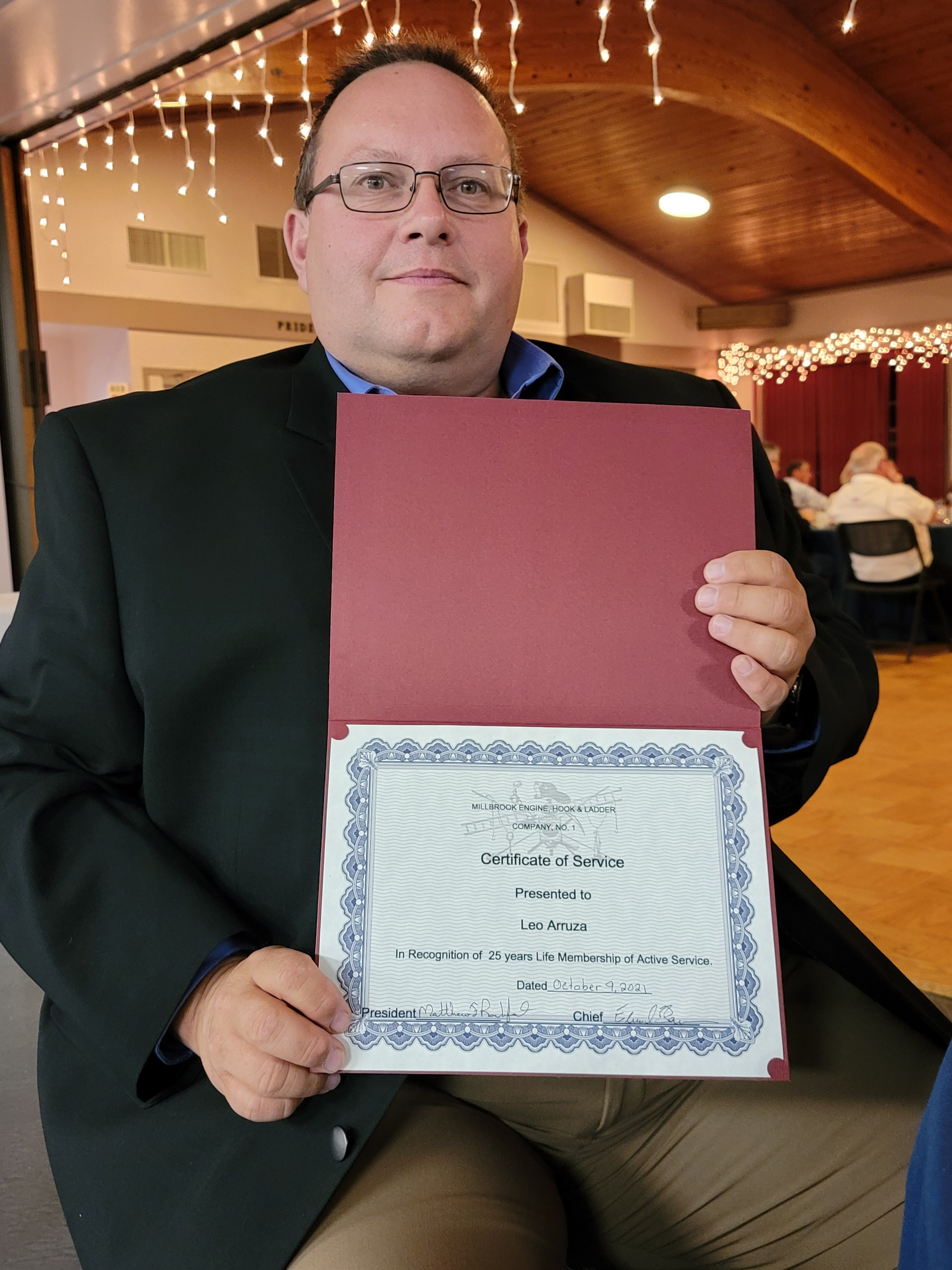 <strong>Leo Arruza held a certificate for 25 years of service at the Millbrook Hook and Ladder Company's annual dinner, where he also was awarded the Lifetime Member's Award.<em>Photoby Judith O'Hara Balfe</em></strong>