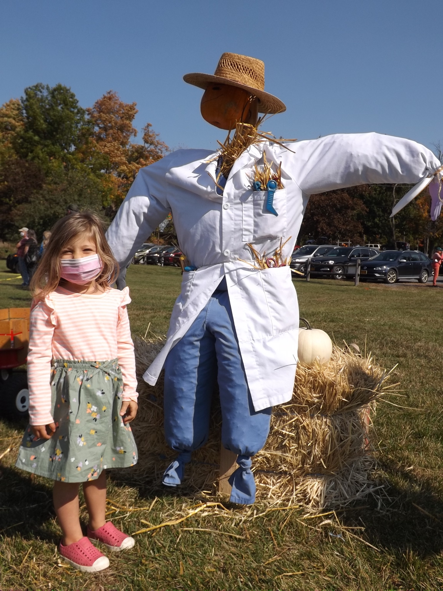 <strong>Leya Baron, 3, above, checked in with Dr. Scarecrow, which Shannon Mays (not pictured) fashioned for Hillsdale's ninth annual Pumpkin Festival on Saturday, Oct. 10.<em>Photo by Kaitlin Lyle</em></strong>