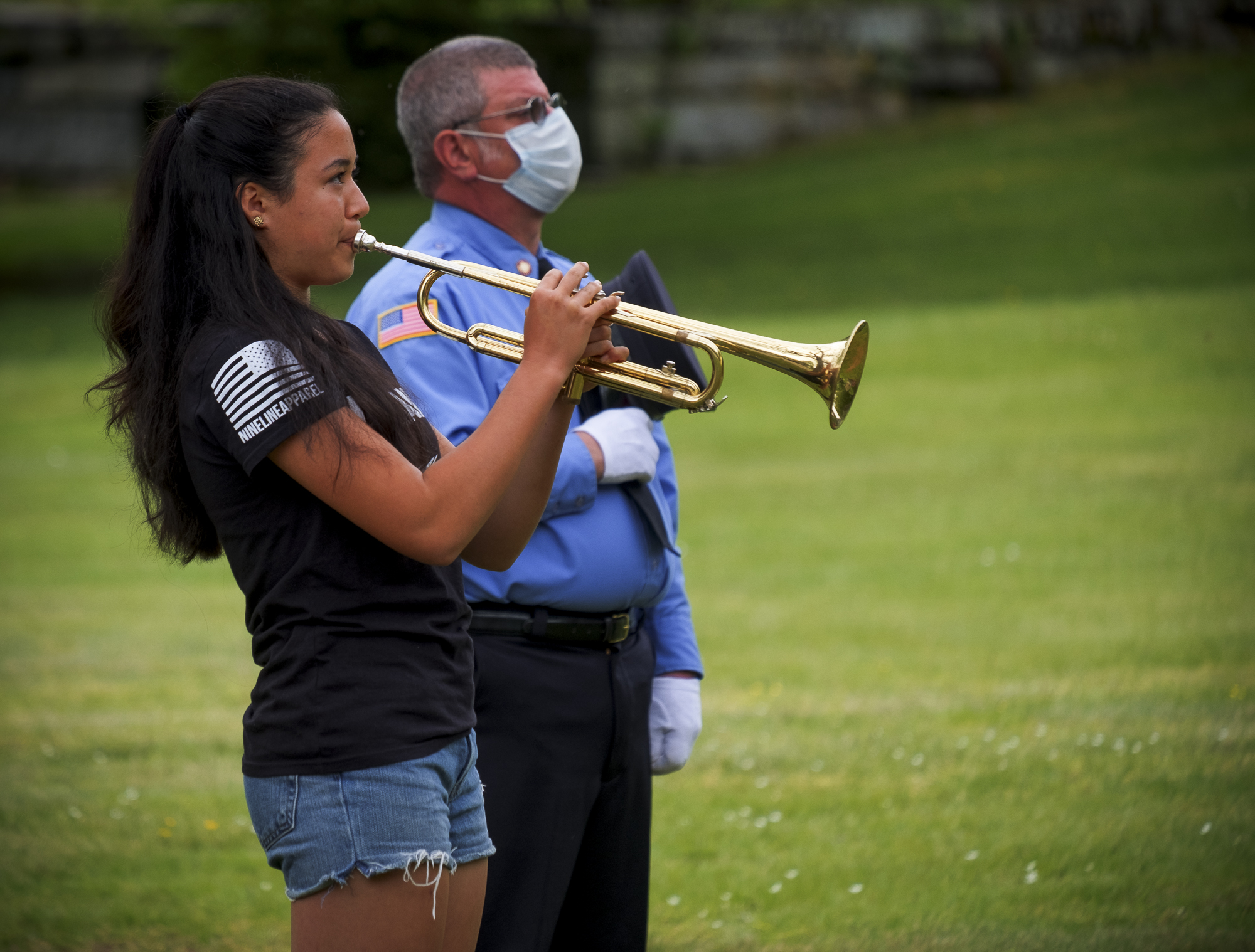 <strong>Melody Matsudaira played taps on Monday, May 25, in Cornwall. <em>Photo by Lazlo Gyorsok</em></strong>