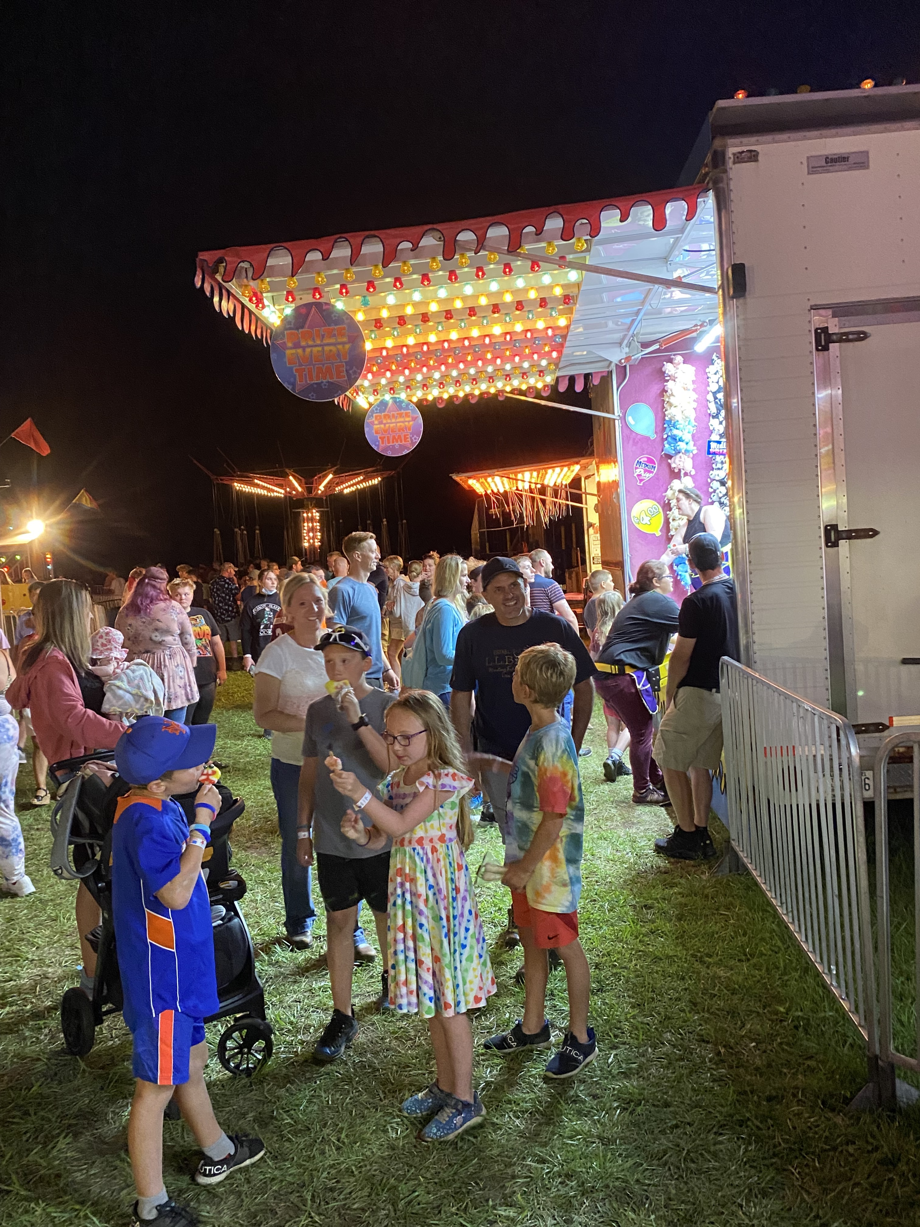 <strong>The carnival was scheduled to end on July 17 but was extended by a week because of heavy rains that week. On Saturday, July 24, the fairground was packed with people.<em>Photoby Cynthia Hochswender</em></strong>