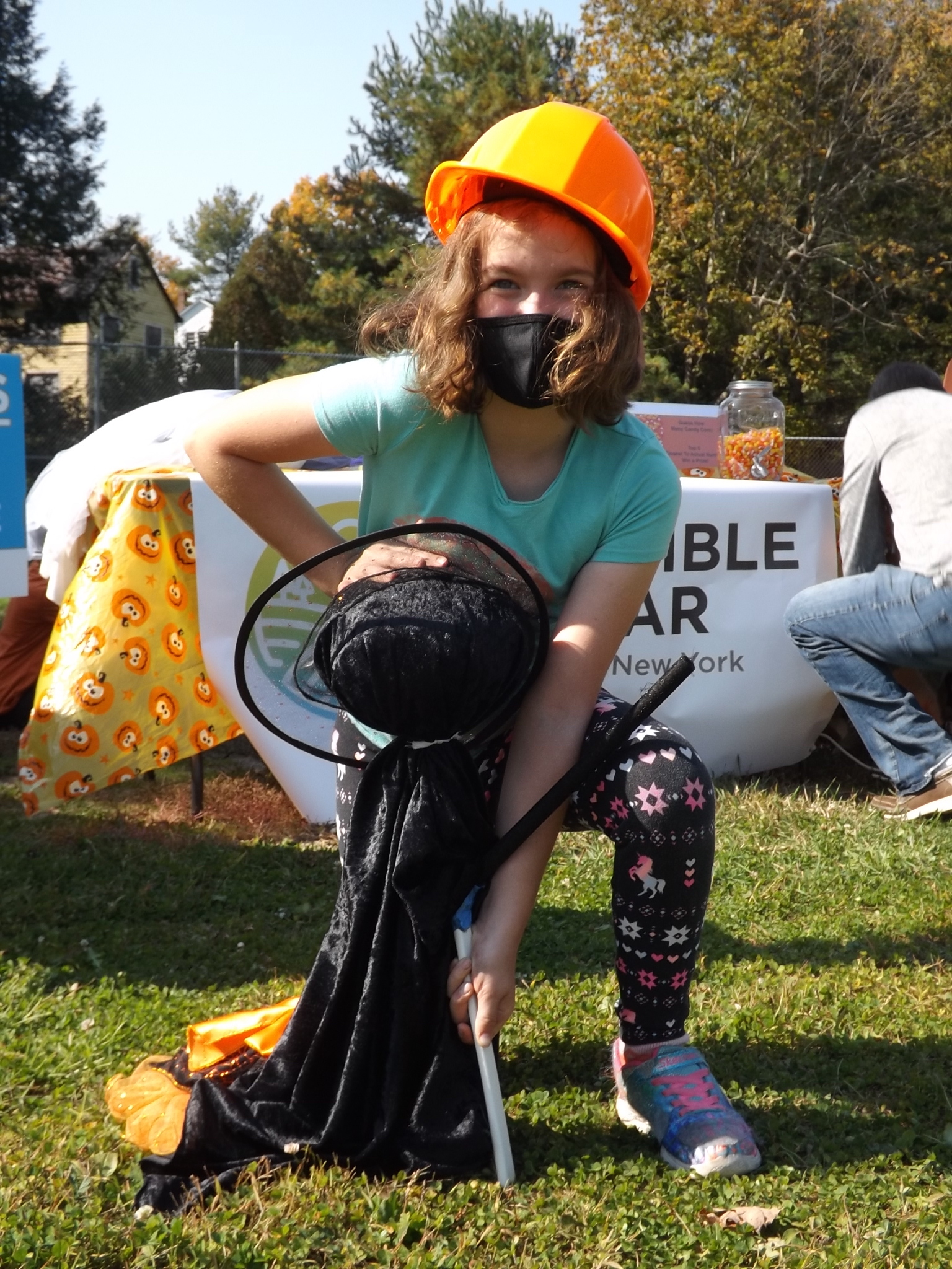 <strong>All while keeping herself protected against COVID-19, Sadie Geogerian, 9, pictured above, helped set up a few ghosts and goblins around Hillsdale's Hamlet Park at the start of the ninth annual Pumpkin Festival. <em>Photo by Kaitlin Lyle</em></strong>
