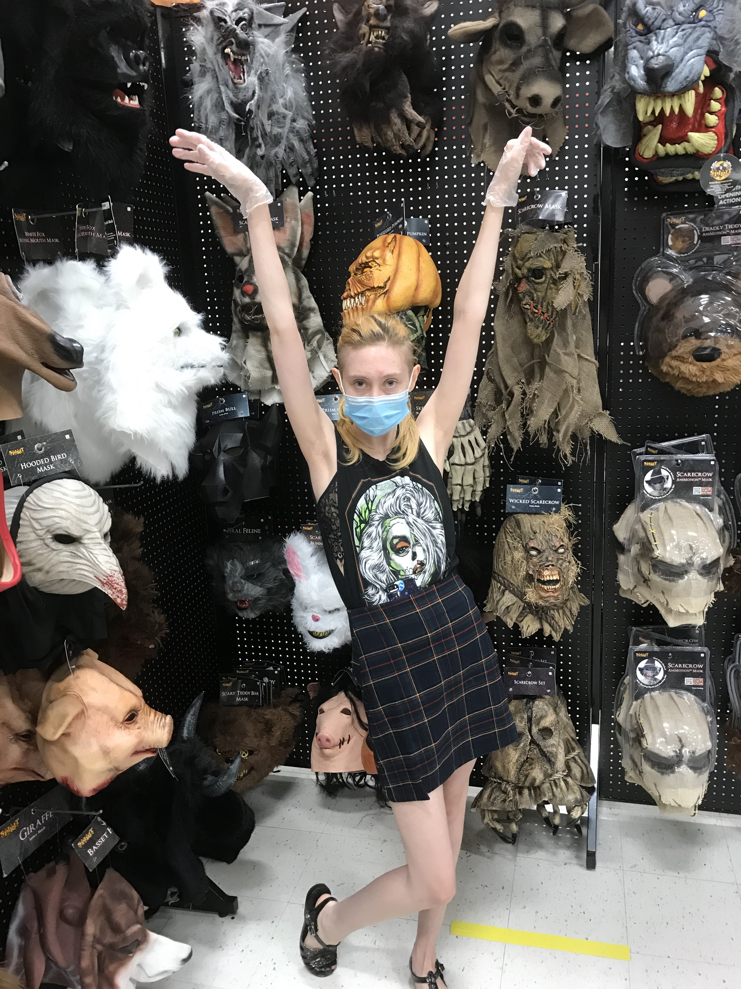 <strong>Author Kate Hochswender, in her happy place: The horror mask display at Spirit Halloween in Kingston, N.Y. <em>P</em></strong><em>hoto by Cynthia Hochswender</em>